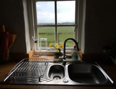 Cottage kitchen sink view